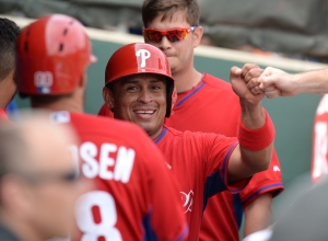 Carlos Ruiz comes into the dugout after scoring a run Tuesday in Clearwater.